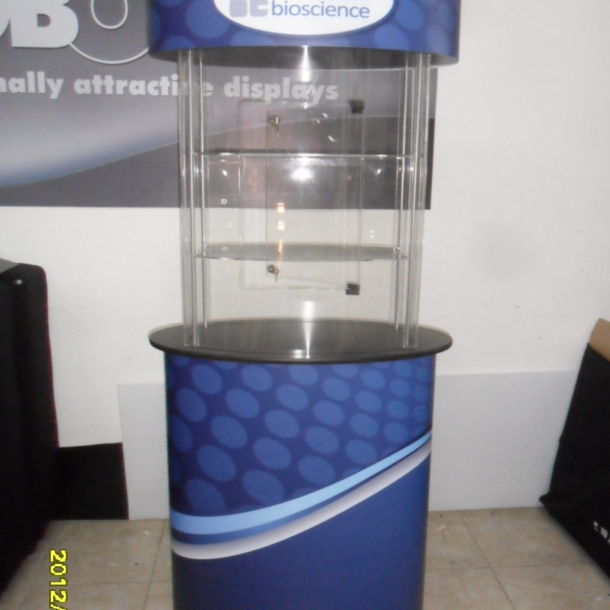 9) Circular Glass Kiosk